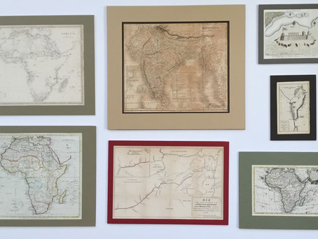 Collage your wall with Custom Framed Maps of your travels.