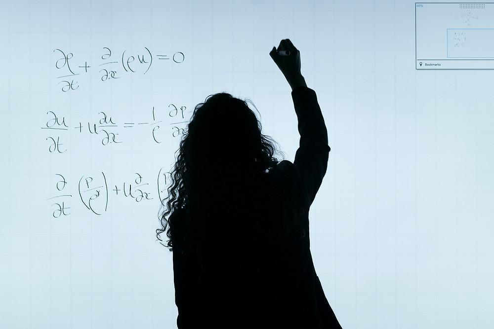 Woman's silhouette in front of a school board