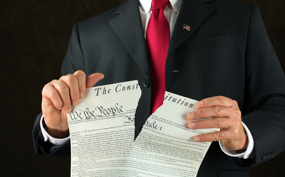 Politician ripping up the US Constitution
