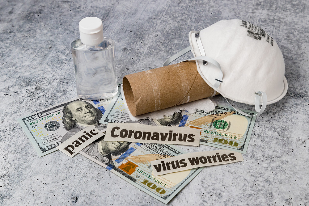 covid-1;- hand sanitizer, face mask, toilet paper roll, and money