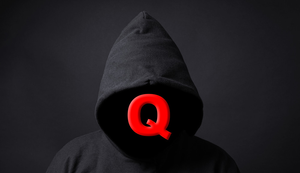 anonymous person with q in replace of their face