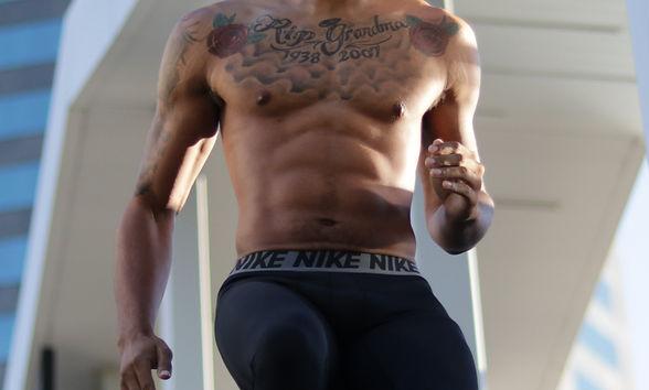 topless-man-in-black-pants-running-20980