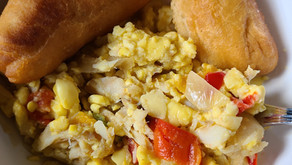 Ackee and Saltfish With Fried Dumplings and Strawberry Carrot Juice