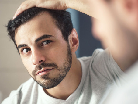 Hair Getting Long in Isolation? Here's How To Use It to Your Advantage.