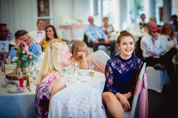 laughing at a wedding