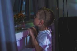 Boy peeping at Joylons