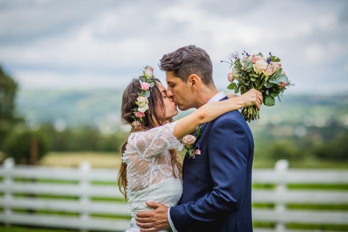 kissing at Llechwen Hall Wedding