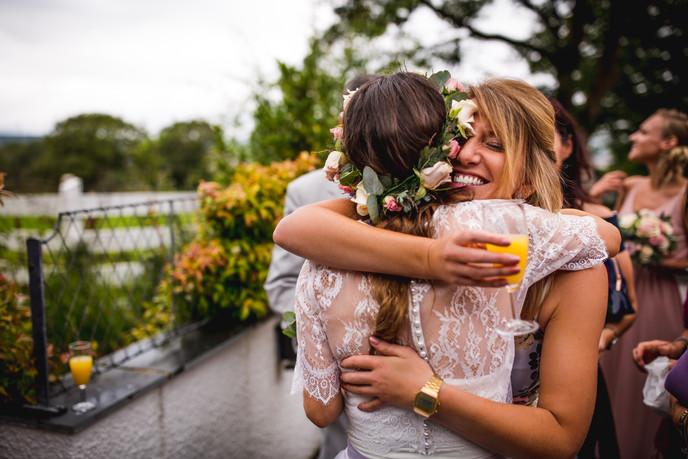 huging at a Cardiff wedding