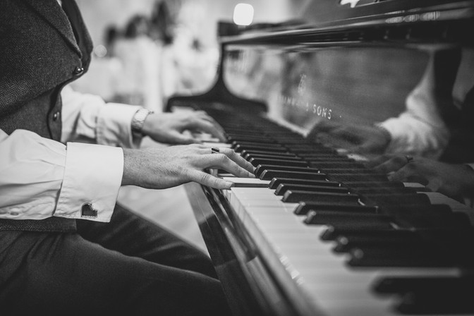 playing the piano at a wedding