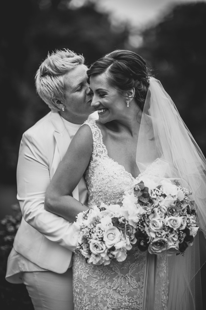 bride kissing at Coed Y Mwstwr wedding