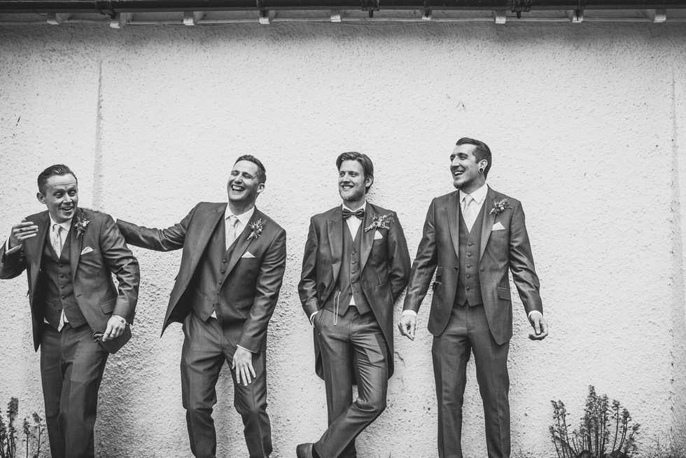 Groom and ushers laughing