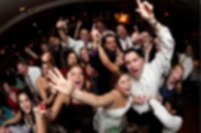 People at a wedding dancing