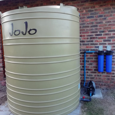 RAINWATER HARVESTING TANK WITH FILTRATION SYSTEM