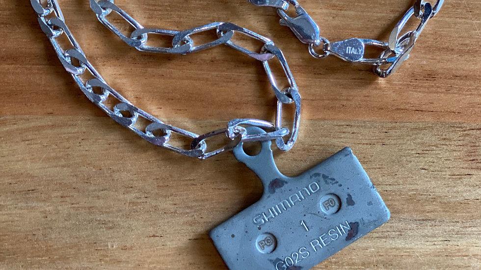 Brake pad necklace
