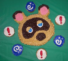Tom Nook Cake and Pitfall Seed FossilCupcakes