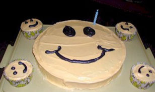 Smiley Face Cake and Cupcakes