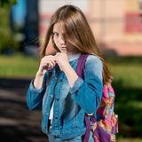 Girl schoolgirl. Summer in nature. It is