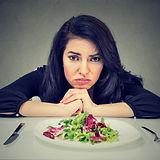 Dieting habits changes. Sad woman hates