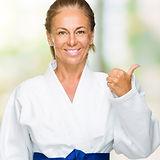 Middle age adult woman wearing karate ki