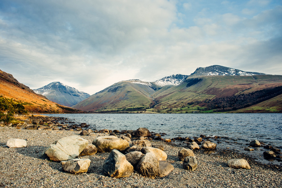 A lake with Scafell Pike mountain in the background
