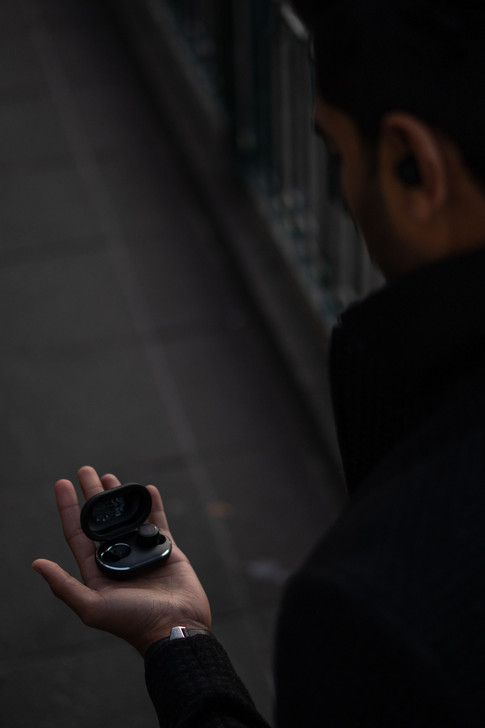 Rae Mano holding Beoplay E8 Identity Cre