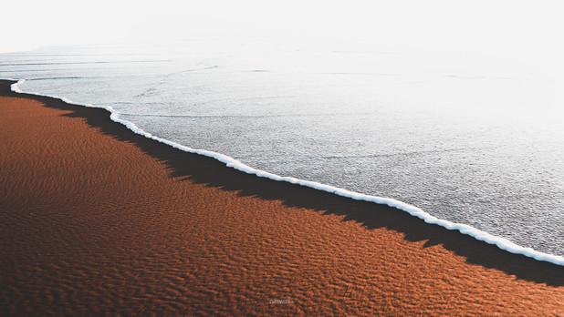Quand l'écume caresse le sable