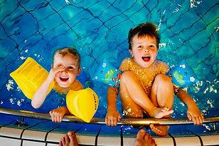 2 children enjoying a swimming pool