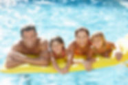 Family swimming together in Crystal Clear residential pool water, fi