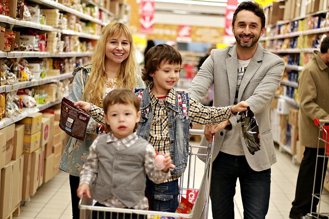 Family shopping to save money at Dollar stores