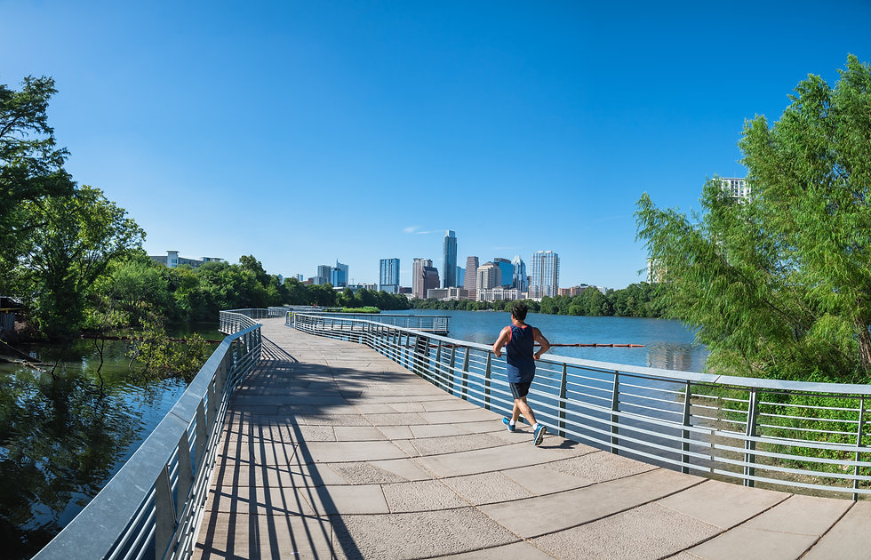 Panorama view Downtown Austin, Texas, US along Colorado River at daytime with cloud blue s