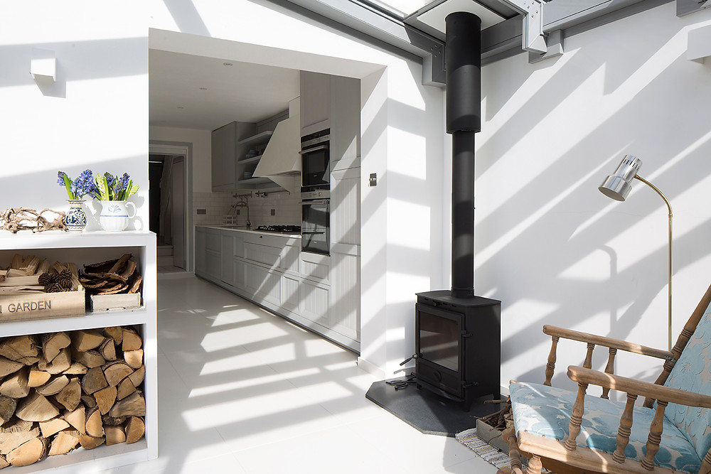 A project I designed at Ardesia Design for a new rear conservatory extension and side return, along with the new DEFRA approved wood burning stove. This Swedish client's home is a contemporary Scandinavian design with many heirloom pieces, such as her old rocking chair, an old wooden dining table and church pew bench.