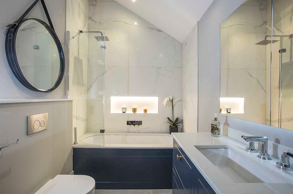 Spencer House, a Development by Mood London - in this bathroom, we used marble tiles - nature never goes out of fashion! We also paired contemporary and traditional bathroom fittings so that the design is an homage to the original period features but not a copy.