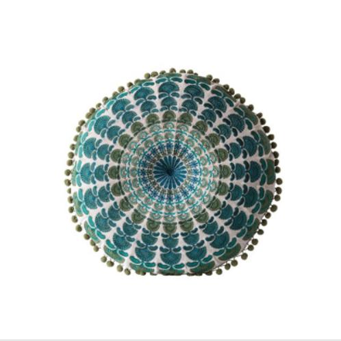 Circle pillow with pom pom trim