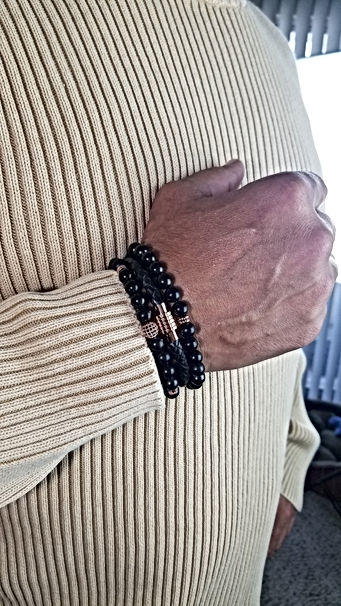 Michael - Braided leather cord bracelet & shungite bead bracelets with rose gold accents EMF protection bracelet lifestyle low-res.jpg