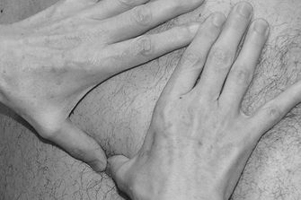 Therapist's hands working on back
