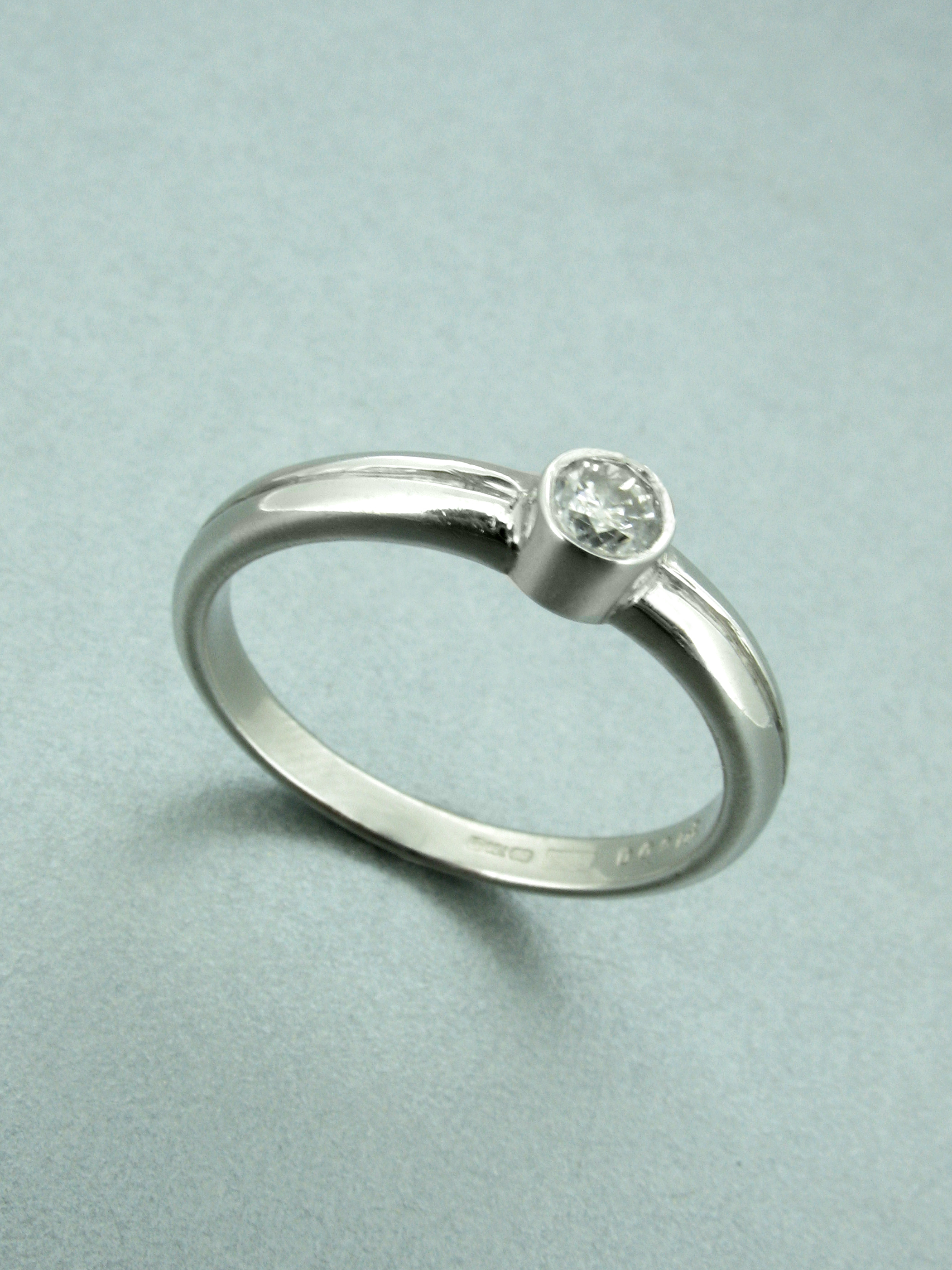 Rub-over Set Diamond Ring