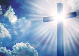 The Cross with bright sun and clouds in