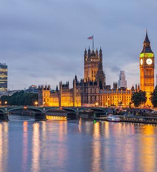 Big Ben and Westminster Bridge at dusk,