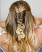 1/2 up 1/2 down bridal look for the bohemian bridal. soft very loose waves and a twisted fishtail braid merging into a 3 strand braid.