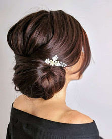 Textured low bun bridal hairstyle perfect for the elegant or classic bride. Hair by Hayley Laws