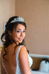 1/2 up 1/2 down wavy or curly bridal hairstyle, with a natural wedding makeup look. Feel like a princess on your wedding day. Hair and Makeup by Hayley Laws