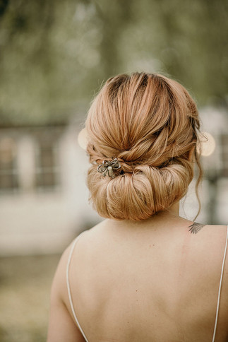 1920s roll hairstyle with a modern twist. Hair by Hayley Laws. Bridal hair and makeup artist in Bromley and Kent.