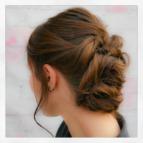 soft twisted bridal bun for the elegant classic bride: by Hayley Laws