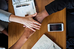 diverse-business-team-stacking-hands.jpg