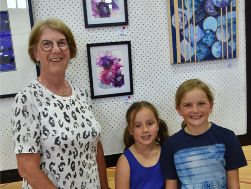 Artist Jane Collier with two happy customers