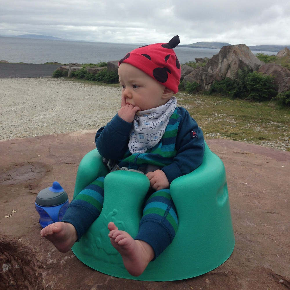 Outdoor baby in Bumbo on Achill Island