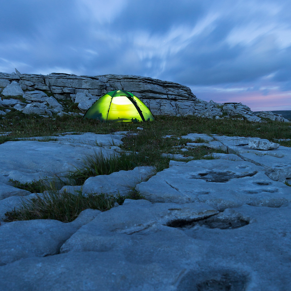 Hilleberg Staika tent at night on the Burren limestone pavement, County Clare, Ireland