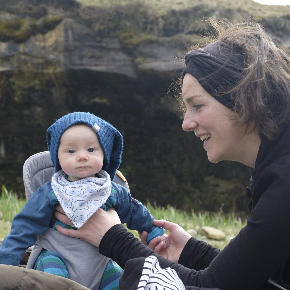 Chilling out with baby on the beach on the Isle of Eigg