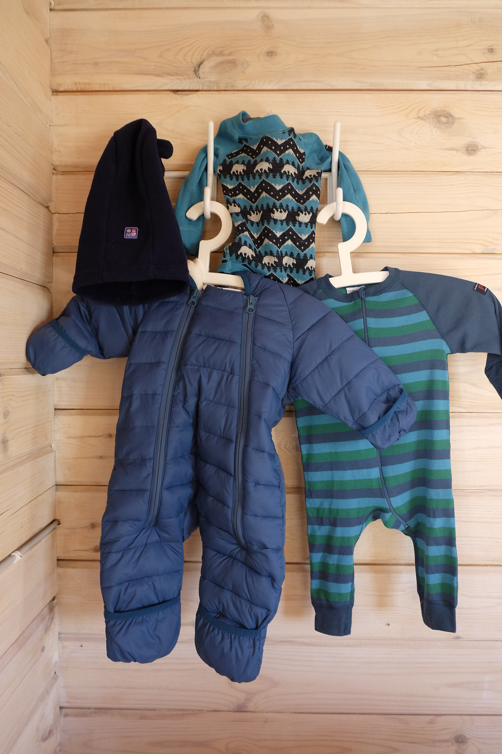 Baby thermal merino wool vest, thermal babygro, and insulated all-in-one suit all from Polarno Pyret. Baby Balaclava from JoJo Maman Bebe
