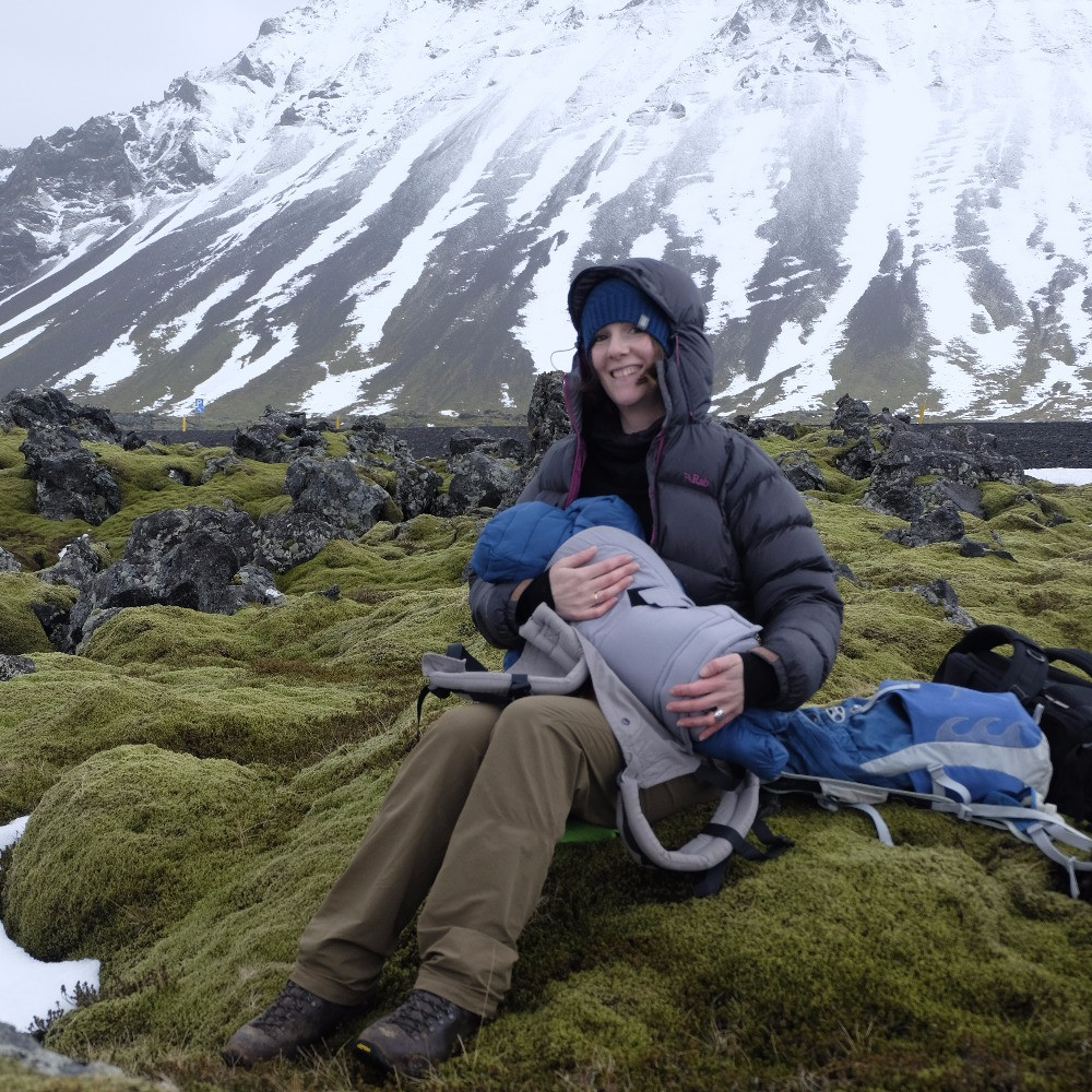 Feeding baby in sub zero temperatures on an Icelandic lava field under a glacier on the Snaefellsnes peninsula